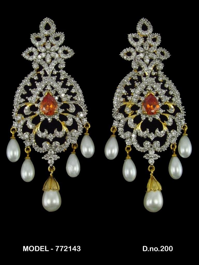 pendientes perlas y piedra naranja