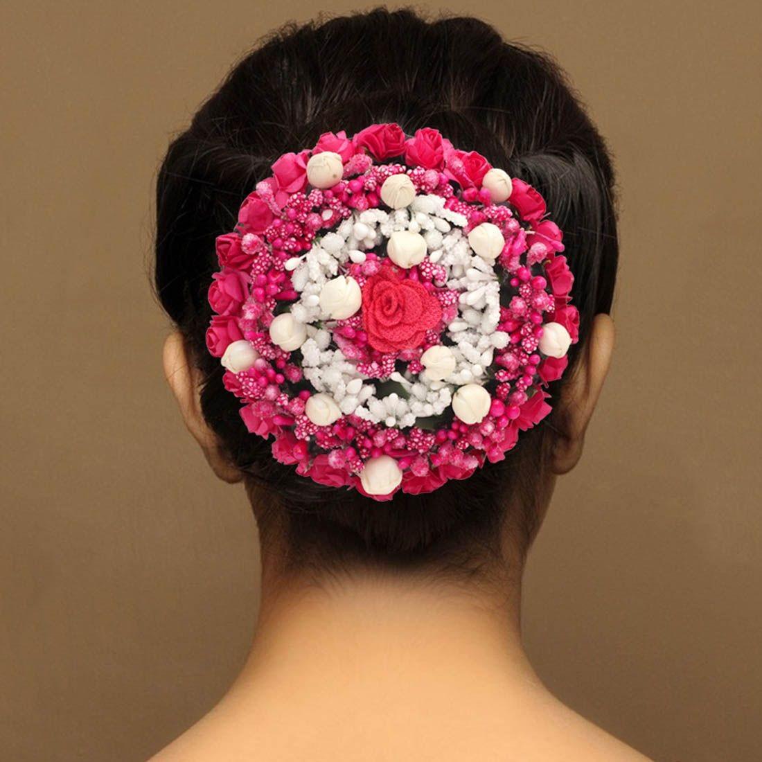 Tocado moño flores fucsias y blancas