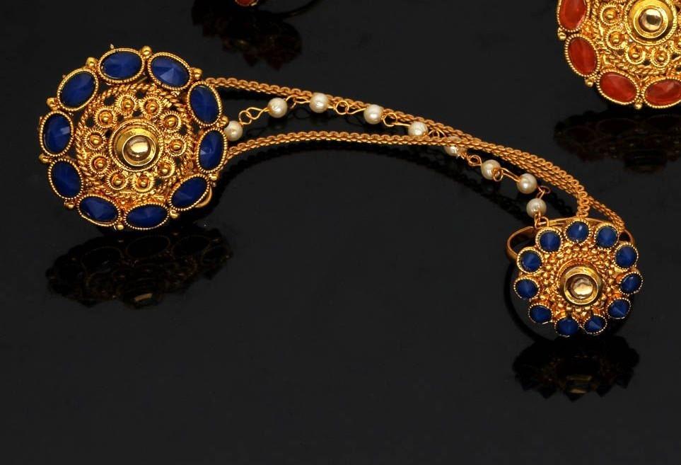 Dos anillos unidos piedras azules