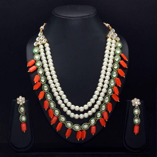 Conjunto perlas y colgantes naranjas