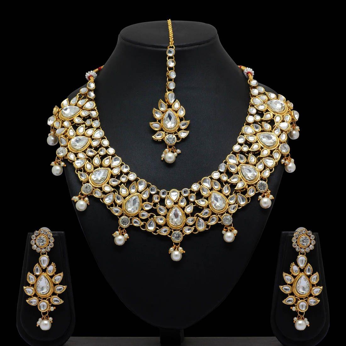 Conjunto piedras y perlas blancas