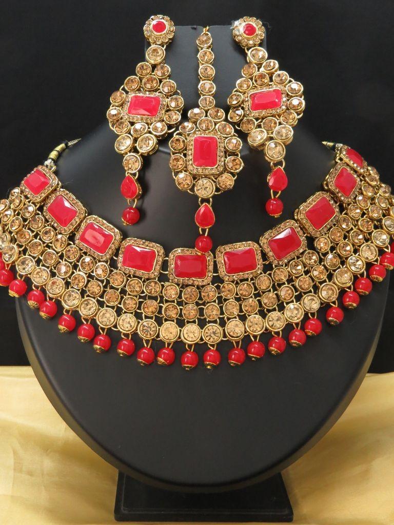 Conjunto piedras doradas y rojas
