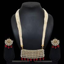 Collar largo perlas y piedras con pendientes flor
