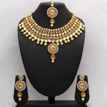 Conjunto piedras doradas y perlas vainilla